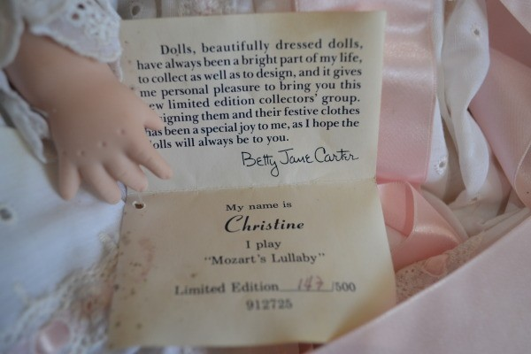 Certificate with doll's name and number.
