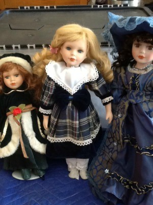 Doll with plaid dress.