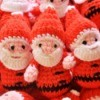 Crochet santas at sale at a craft bazaar.