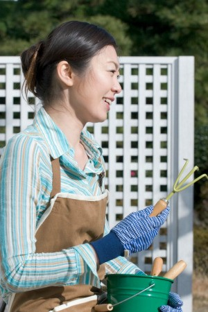 A woman wearing clothing appropriate for gardening.