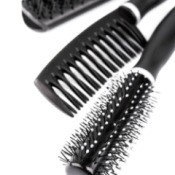 Two hair brushes and a comb.