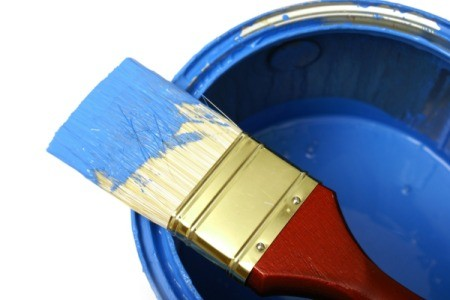 A can of blue paint.