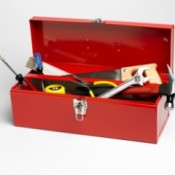 A red toolbox with tools.