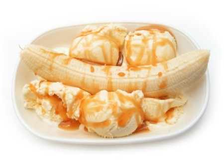 A banana split with butterscotch sauce.