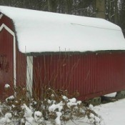 Snow covered shed.