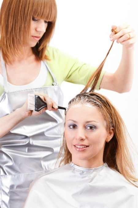 A woman having her hair dyed.