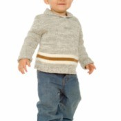 A toddler wearing jeans and a sweater.