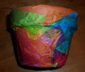 Clay flower pot covered with tissue paper.