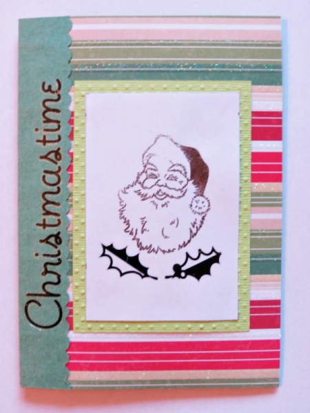 Adding stamped Santa and holly leaves.