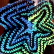 Blue, green, and black crochet star.