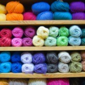 Colorful yarn on a shelf.