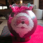 Santa painted on bud vase.