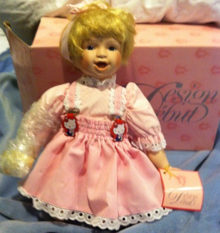 Kneeling doll in pink dress.