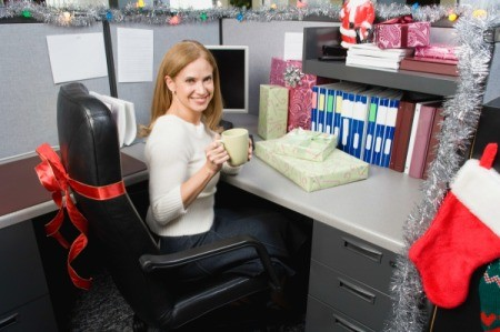 A cubicle decorated for Christmas.
