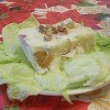 Piece of salad on bed of lettuce.
