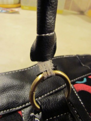 Closeup of purse strap.