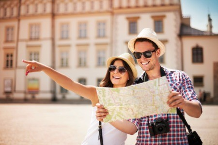 A man and a woman enjoying being tourists.