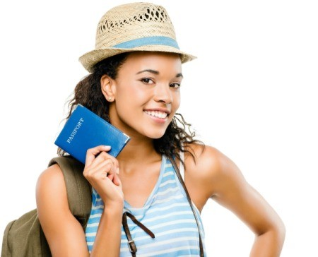 A young woman holding a passport.