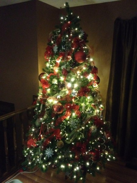 Tree with brighter lights in center section.