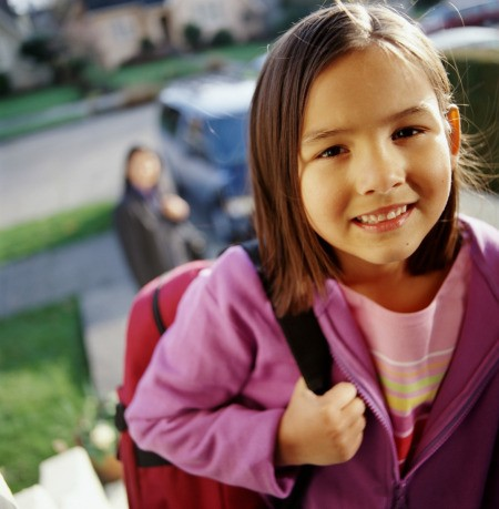 Girl Leaving For First Day Of School