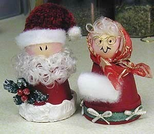 Santa and Mrs. Claus made from clay flower pots.