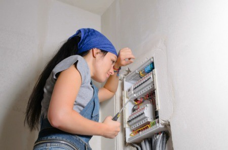 Woman Troubleshooting Wiring Problem
