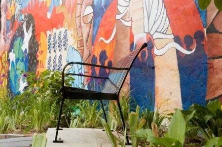 Chair in Front of Public Mural