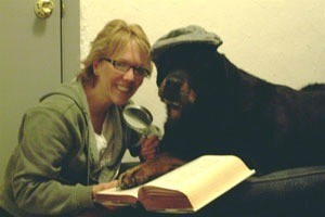 Snoop with owner reading.