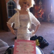 Diana doll wearing a white dress.
