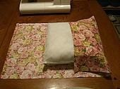 Fold fabric over pillow to make pocket.