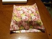Fabric folded over pillow.