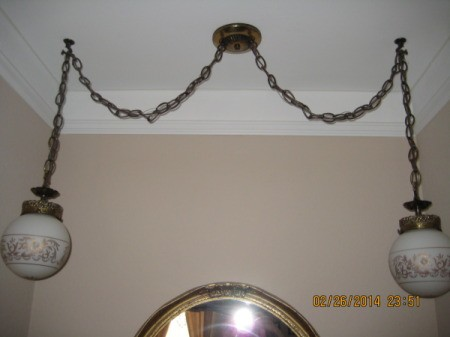 Light fixture with central mount and two chain mounted globes.