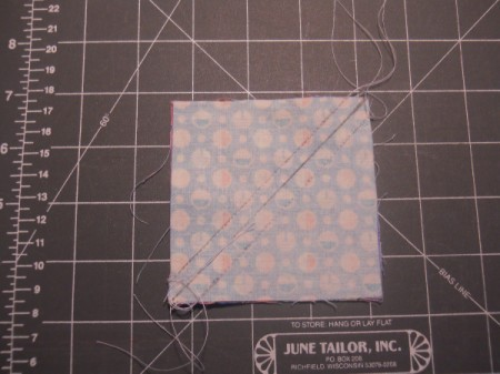 how to use a rotary cutter to cut quilt squares