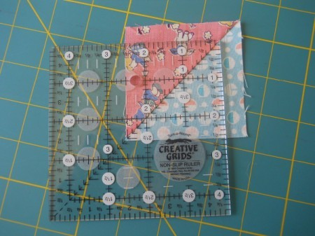 Fabric square and ruler.