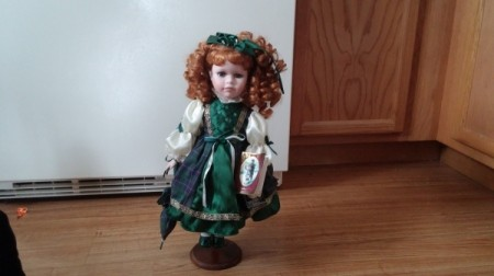 Doll in green outfit.