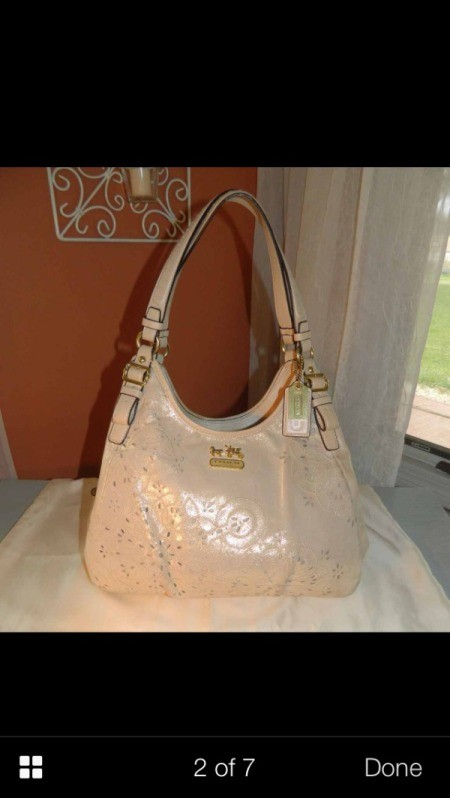 Gold coach purse.