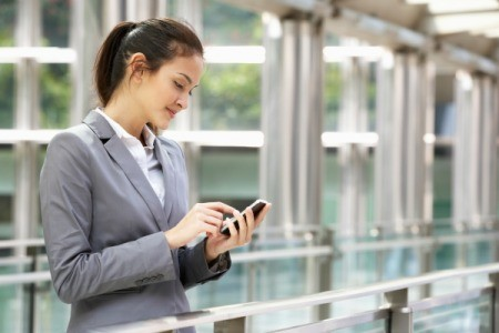 Business Woman Using Cell Phone