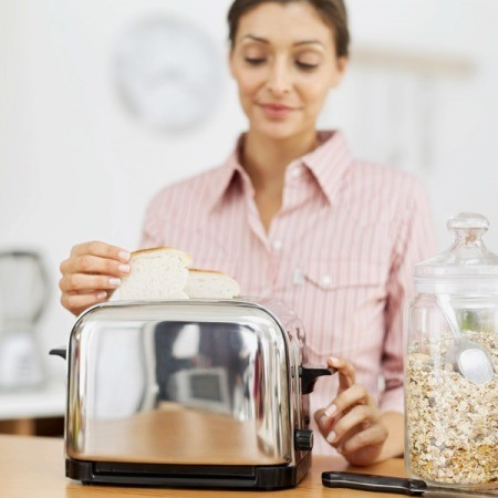 Woman Using Toaster