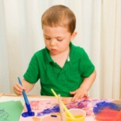 Child Painting at Play Table