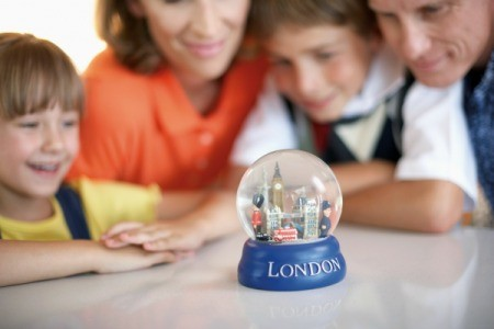 Family Looking at London Snow Globe