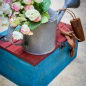 Artificial Flowers in the Garden Watering Can
