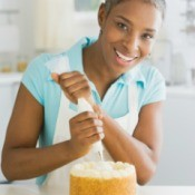 Woman Frosting a Cake
