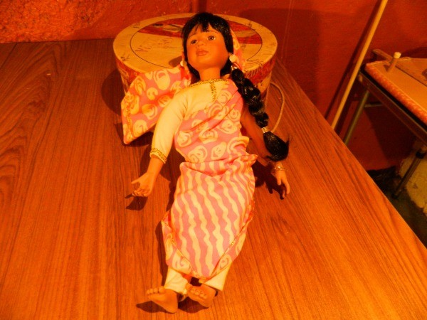 Doll with long skirt and braid.