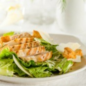 A healthy salad with chicken breast.