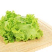 Lettuce on a cutting board.
