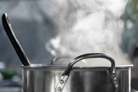 Stew cooking in a stainless steel pan.