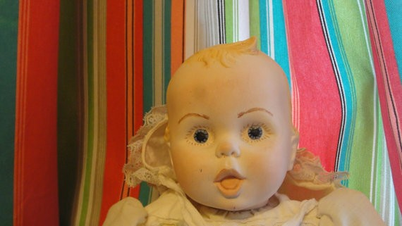 Baby doll with bonnet off.