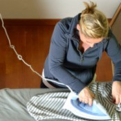 A woman ironing clothing.
