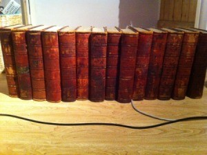 Old encyclopedias with red binding.