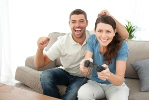 Happy Couple Playing Video Game